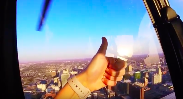 Thumbs up while in helicopter hovering over Kansas City